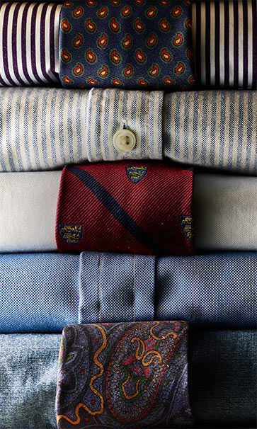 Close-up of dress shirts & ties in various patterns & colors