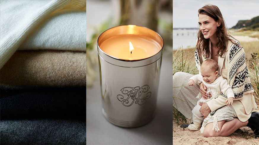 Folded sweaters; candle; & woman with baby in cream-toned outfits