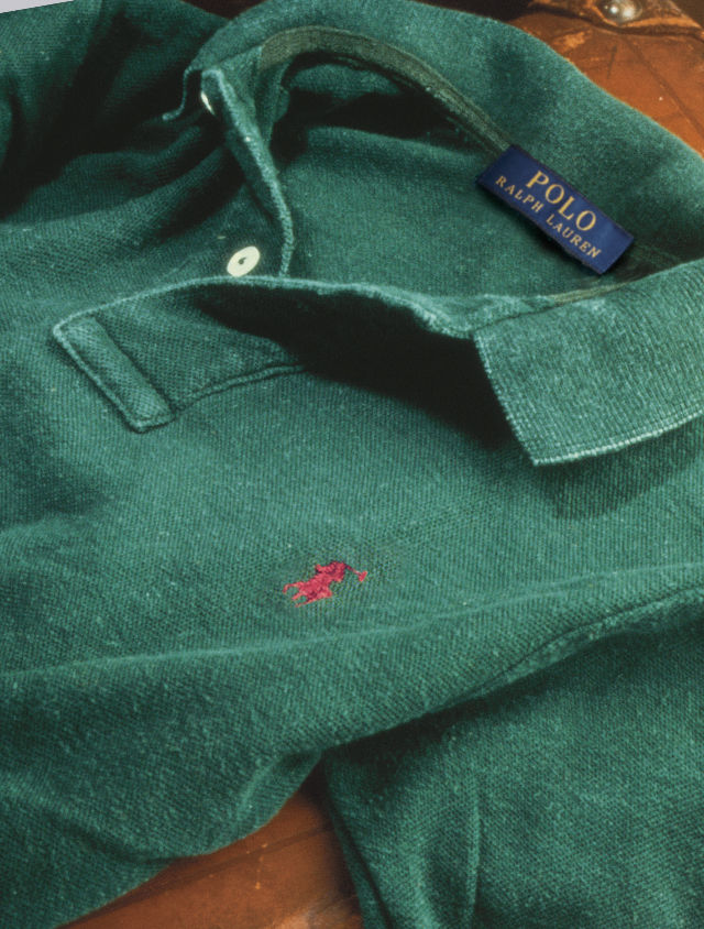 Green Polo shirt with  red signature embroidered pony.