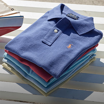 Stack of folded Polo shirts in navy, red, light blue, and light green.