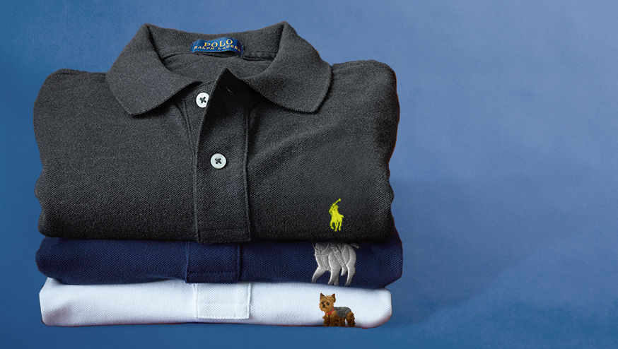 Stack of folded Polo shirts in grey, navy, and white.