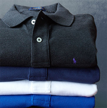 Stack of folded Polo shirts in black, navy, white & royal blue