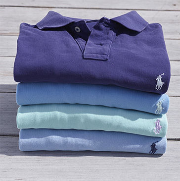 Stack of folded Polo shirts in purple, light blue & pale green